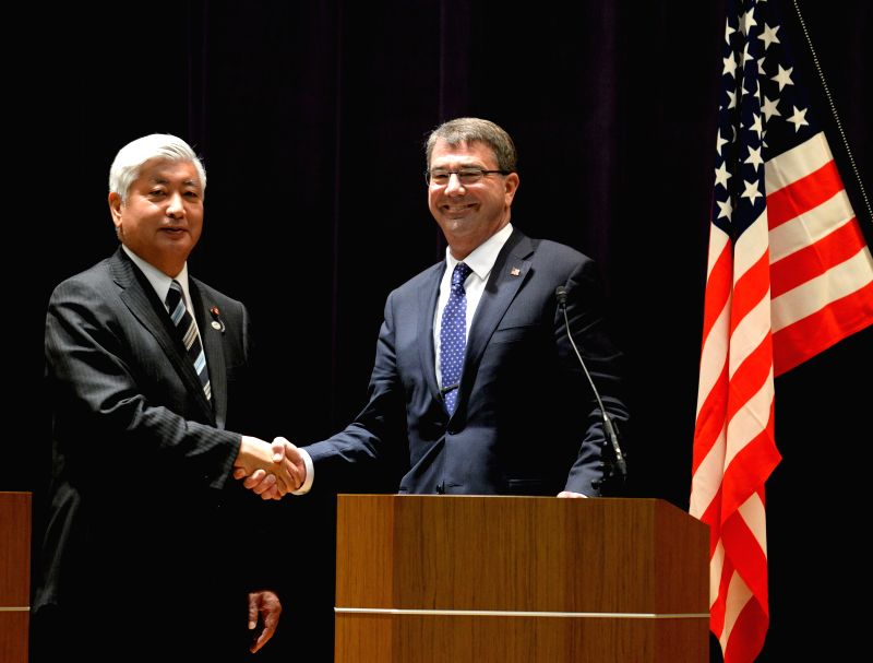 Japan`s defense minister Gen Nakatani meets with US Secretary of Defense Ashton Carter in Tokyo, April 8, 2015.