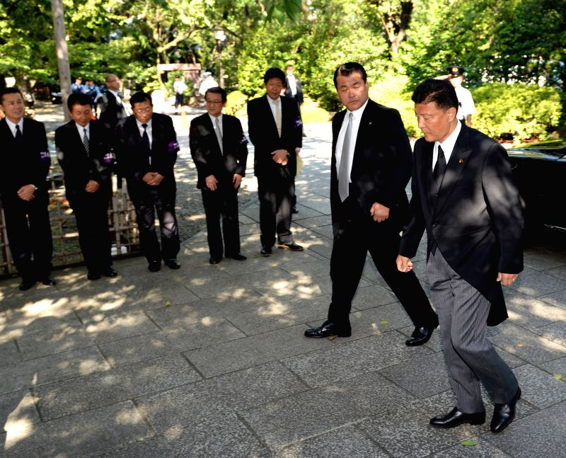Japanese Internal Affairs Minister Yoshitaka Shindo (1st R) arrives to visit the Yasukuni Shrine in Tokyo, Japan, Aug. 15, 2014. Yoshitaka Shindo visited the ...