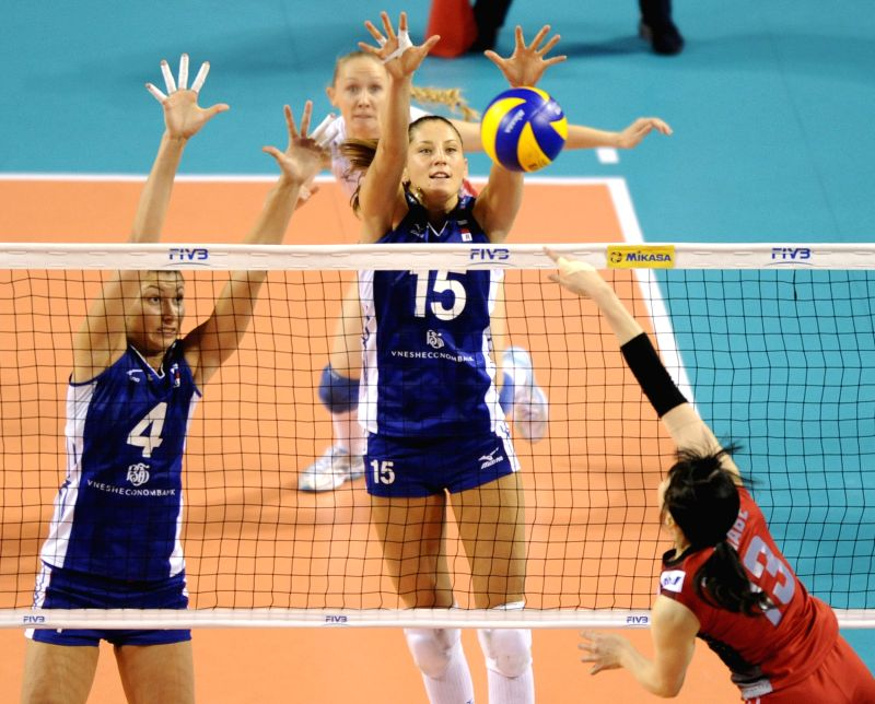 Irina Zaryazhko (L) and Titiana Kosheleva (C) of Russia block the ball against Japan during the final round match of FIVB Women's Volleyball World Grand Prix in ...