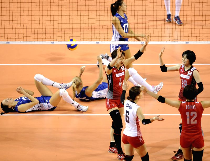 Japanese players celebrate after scoring a point against Russia during the final round match of FIVB Women's Volleyball World Grand Prix in Tokyo, Japan, Aug. 20, ...