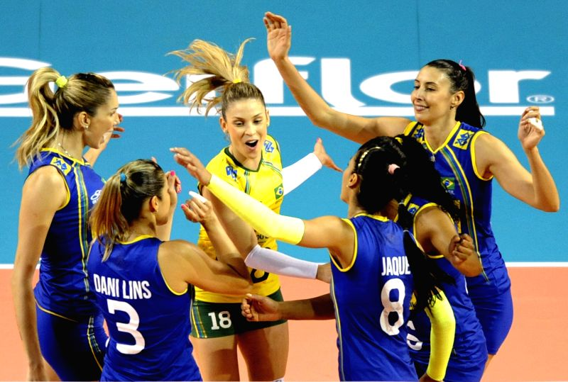 Brazilian players celebrate for a score during the Final Round match of FIVB Women's Volleyball World Grand Prix 2014 against China in Tokyo, Japan, Aug. 21, 2014. ...