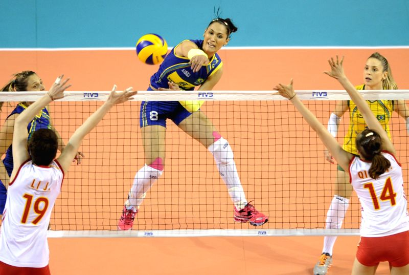 Carvalho Jaqueline (C) of Brazil spikes the ball during the Final Round match of FIVB Women's Volleyball World Grand Prix 2014 against China in Tokyo, Japan, Aug. 21,