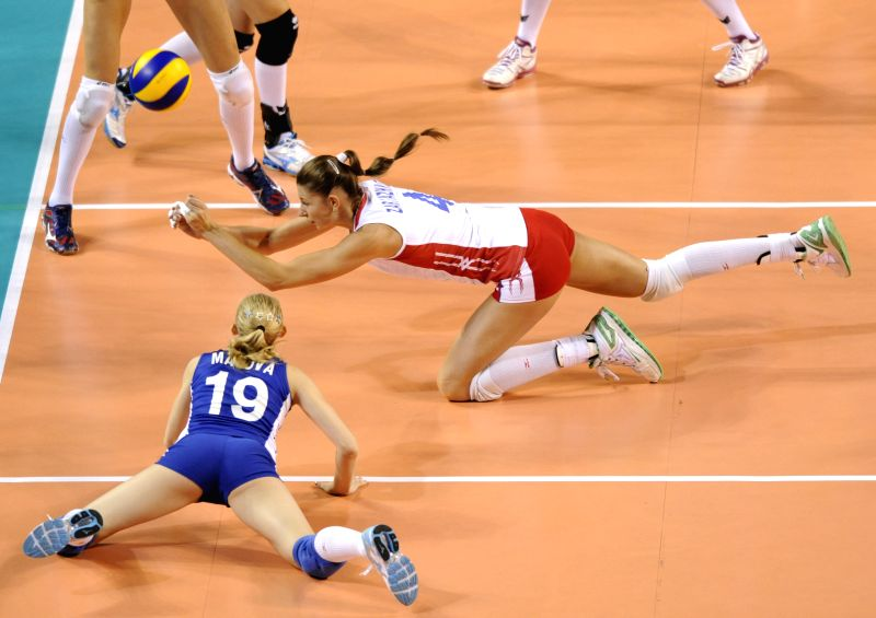 Irina Zaryazhko (R) of Russia vies for the ball during the Final Round match of FIVB Women's Volleyball World Grand Prix 2014 against Belgium in Tokyo, Japan, Aug. ...