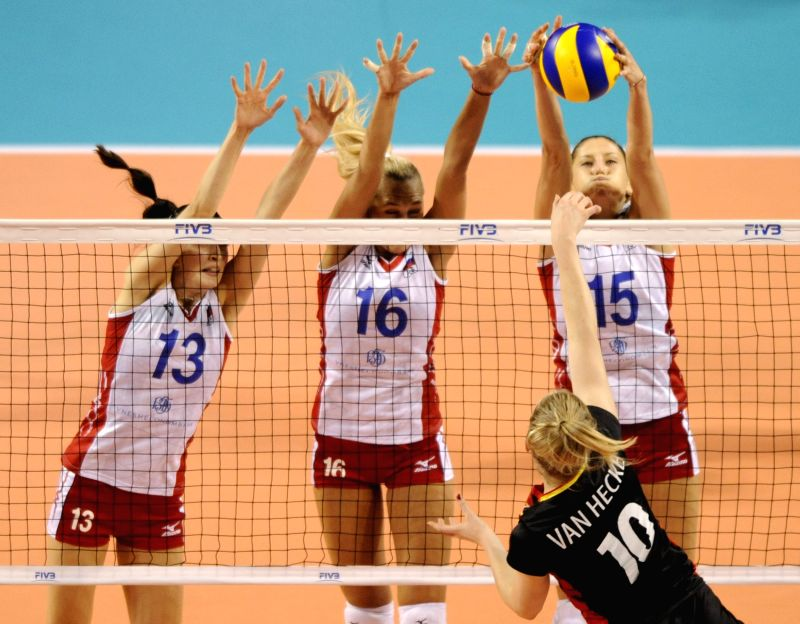 Players of Russia block the ball during the Final Round match of FIVB Women's Volleyball World Grand Prix 2014 against Belgium in Tokyo, Japan, Aug. 21, 2014. Russia .