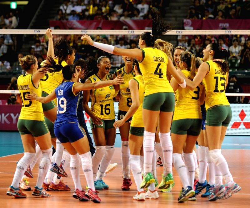 Brazilian players react after winning the game agasinst Japan of the final round match of FIVB Women's Volleyball World Grand Prix 2014 in Tokyo, Japan, Aug. 24, ...