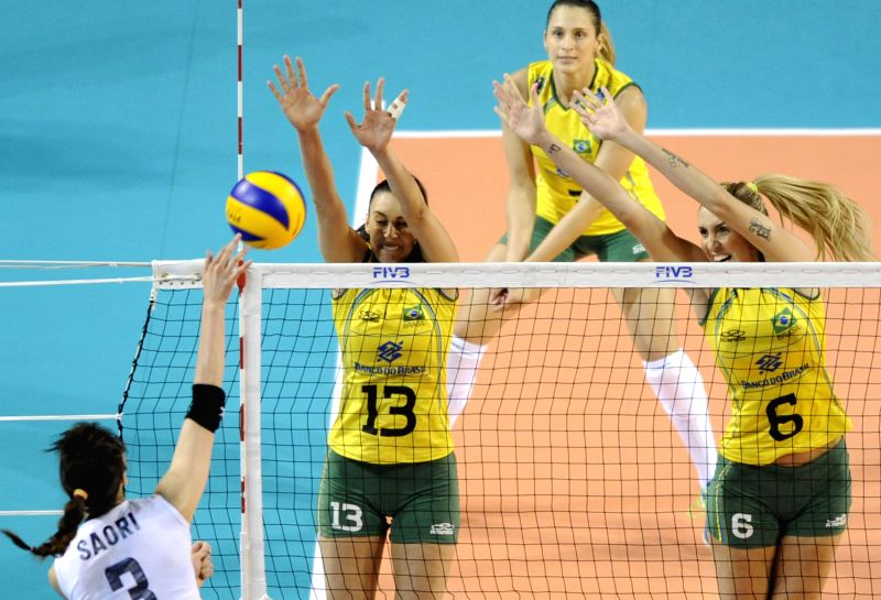 Sheilla Tavares de Castro Blassiolli (2nd L) and Thaisa Menezes (1st R) of Brazil block the ball against Japan during the final round match of FIVB Women's Volleyball