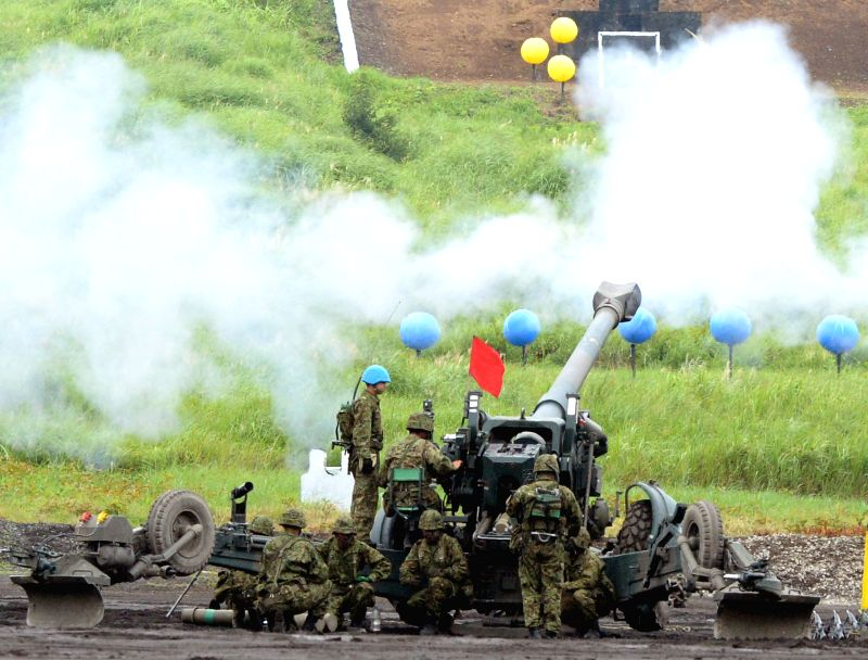 The Japanese Ground Self-Defense Forces (GSDF) attend live-fire drill at foothill of Mt. Fuji, Aug. 24, 2104. The Japanese  GSDF on Sunday held an annual live-fire ... - Itsunori Onodera