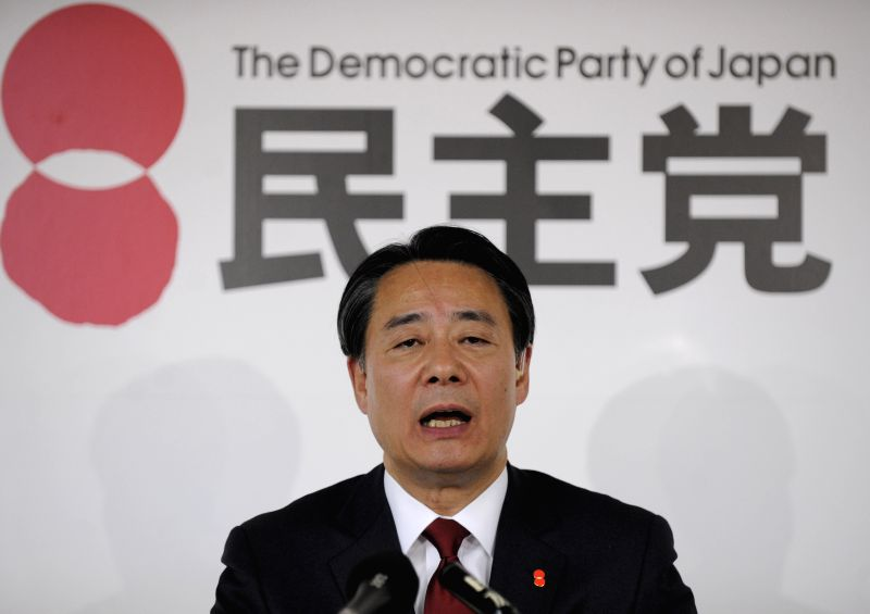 Japan's main opposition Democratic Party of Japan (DPJ) leader Banri Kaieda answers questions from press at the party's headquarter in Tokyo, Japan, Dec. 14, ...