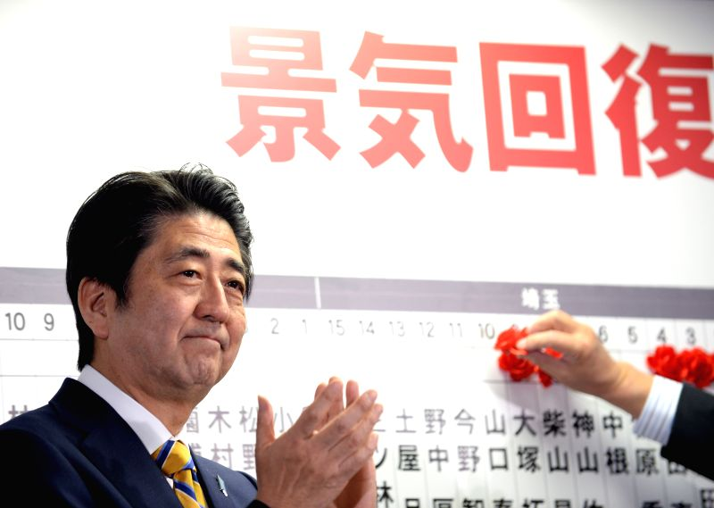 Japan's Prime Minister Shinzo Abe claps at the headquarters of Japan's Liberal Democratic Party (LDP) in Tokyo, Dec. 14, 2014. LDP and its small partner the Komeito .. - Shinzo Abe