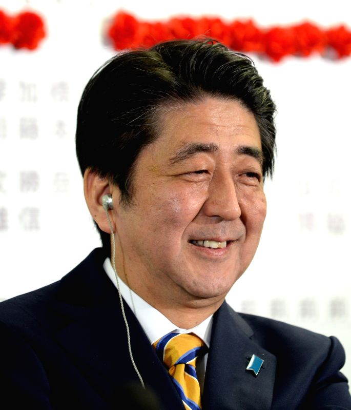 Japan's Prime Minister Shinzo Abe smiles at the headquarters of Japan's Liberal Democratic Party (LDP) in Tokyo, Dec. 14, 2014. LDP and its small partner the Komeito . - Shinzo Abe