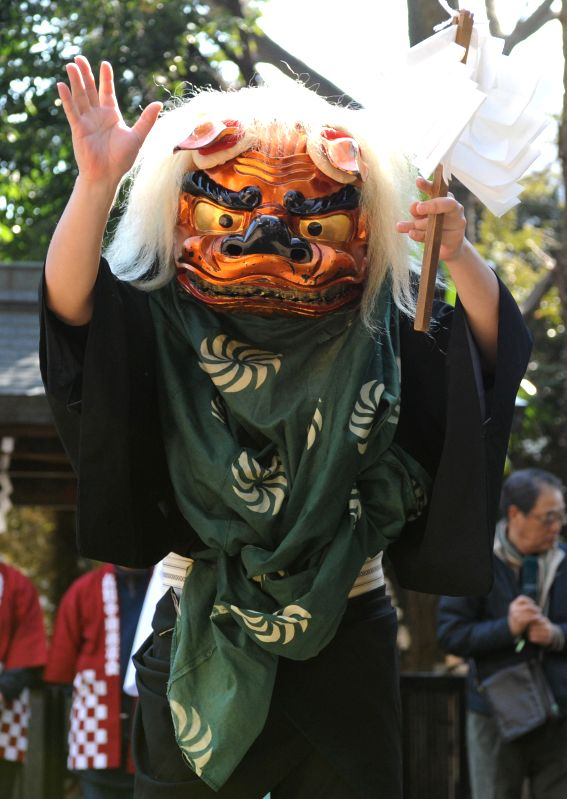 A lion dance is performed to exorcise evils and wish good luck at Hikawa Shrine in Tokyo, Japan, Feb. 11, 2015.