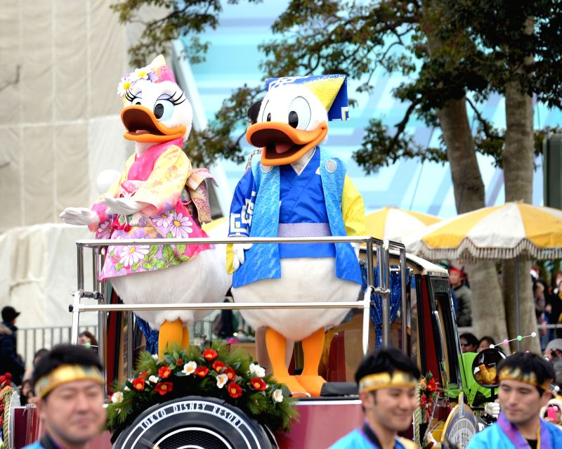 Disney characters wave to guests on a float during a New Year parade at Tokyo Disneyland in Tokyo, Japan on Jan. 1, 2015.
