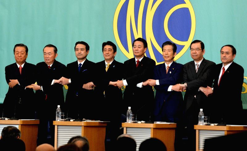 Tokyo (Japan): Japanese Prime Minister and President of the Liberal Democratic Party (LDP) Shinzo Abe (4th L) and presidents of opposition parties pose for a group photo during a debate held in the ..