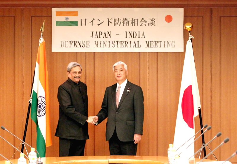 Tokyo (Japan): Union Defence Minister Manohar Parrikar shakes hands with his Japanese counterpart General Nakatani during a Defence Ministerial Meeting, at Tokyo, in Japan on March 30, 2015.