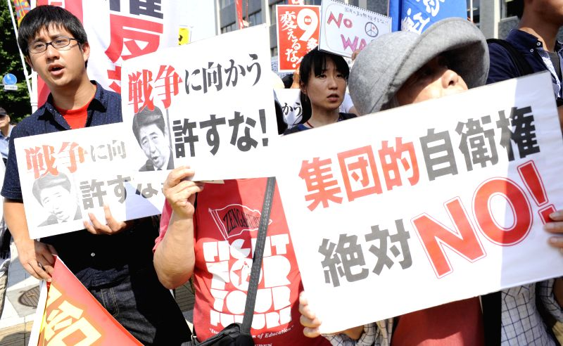 People attend a protest against the right for collective self-defense in front of Prime Minister Shinzo Abe's official residence in Tokyo, Japan, July 1, 2014. The ... - Shinzo A