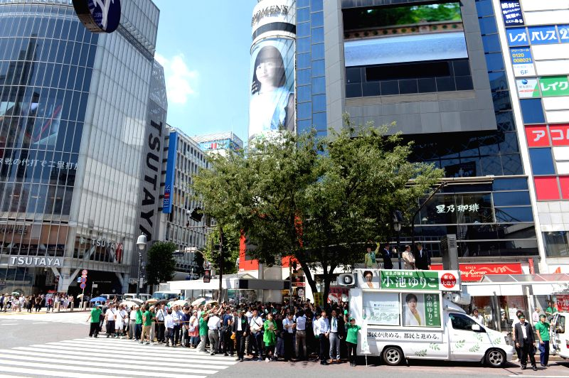 TOKYO, July 29, 2016 - Yuriko Koike (1st L on the van), Japan's former defense minister and candidate for Tokyo's gubernatorial election, delivers a speech to passersby in Tokyo, Japan, July 29, ...