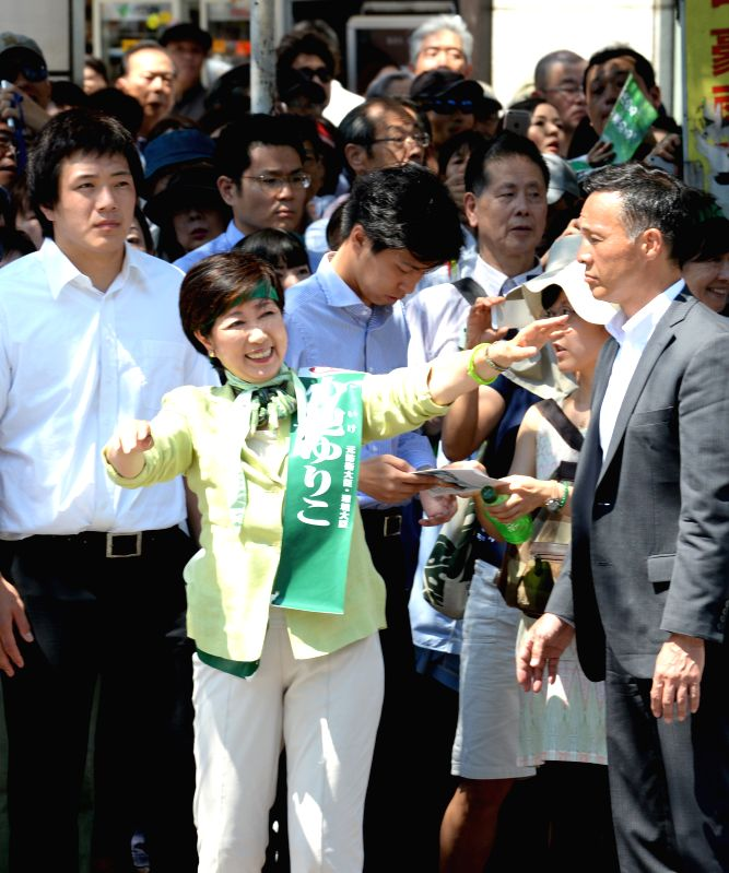 TOKYO, July 29, 2016 - Yuriko Koike (front), Japan's former defense minister and candidate for Tokyo's gubernatorial election, greets supporters in Tokyo, Japan, July 29, 2016. 21 candidates for the ...