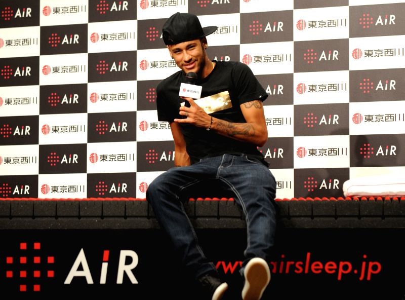 Brazilian soccor player Neymar speaks during a promotional event held by his sponsor in Tokyo, Japan, July 31, 2014.