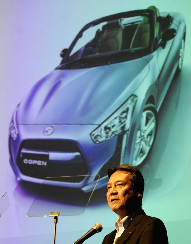 Japanese auto maker DAIHATSU's President Masanori Mitsui speaks during a press conference in Tokyo, Japan, on June 19, 2014. DAIHATSU has released a new model of ...