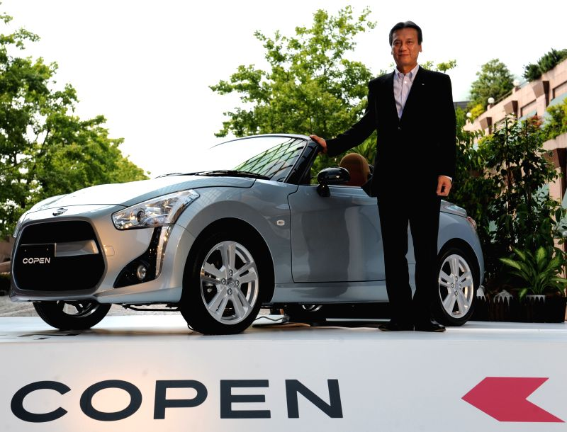 Japanese auto maker DAIHATSU's President Masanori Mitsui poses for photograph during a press conference in Tokyo, Japan, on June 19, 2014. DAIHATSU has released a new