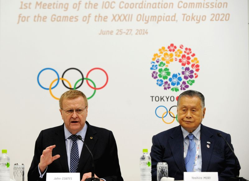 International Olympic Committee (IOC) Vice President John Coates (L) and President of the Tokyo Organizing Committee of the Olympic and Paralympic Games Yoshio Mori ..