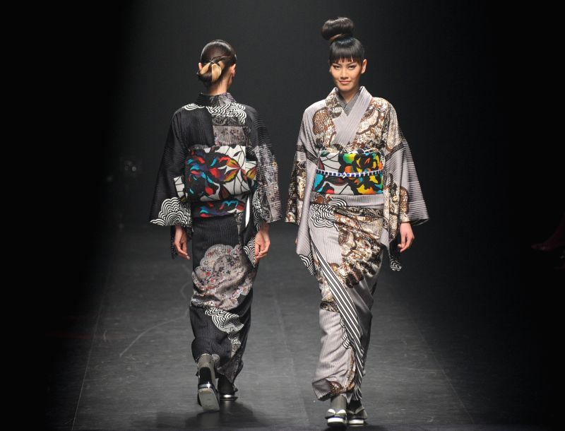 Models display creations designed by Jotaro Saito during the Tokyo Fashion Week 2015 Autumn/Winter collection in Tokyo, Japan, March 19, 2015.