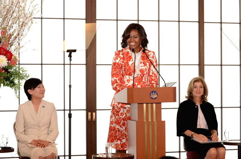 U.S. first lady Michelle Obama (C) speaks in Tokyo, Japan, March 19, 2015. U.S. first lady Michelle Obama stressed collaboration with Japan in advancing girls ...