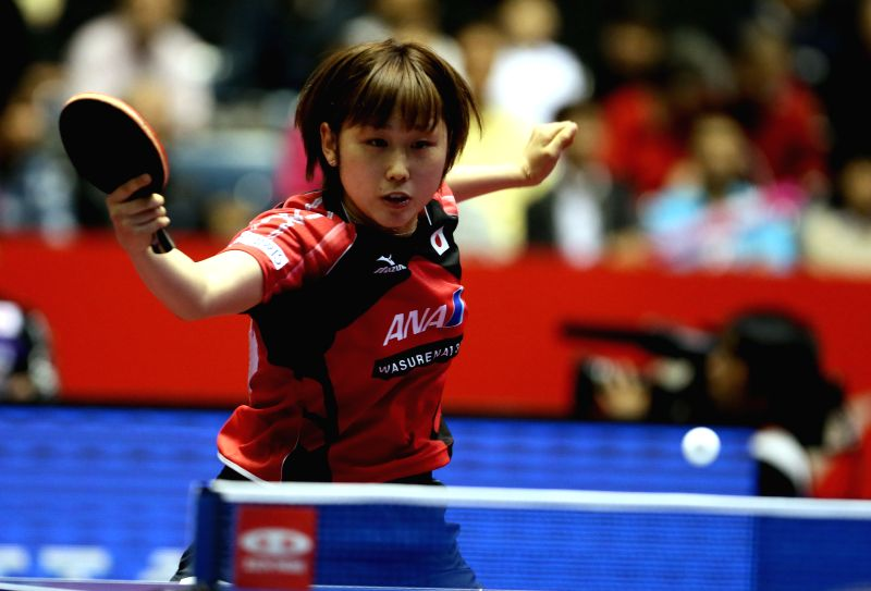 Japan's Tashiro Saki returns a shot to Australia's Melissa Tapper during their women's team event at the Zen Noh 2014 World Table Tennis Championships in Tokyo, Japan, .