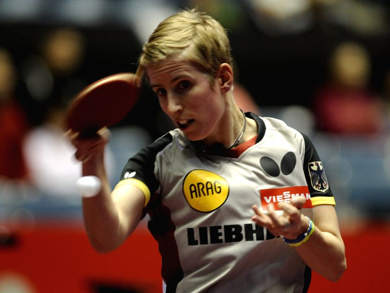 Kristin Silbereisen of Germany plays against Ana-Maria Erdelji of Serbia during the single's match in Zen Noh 2014 World Table Tennis Championships in Tokyo, Japan, May