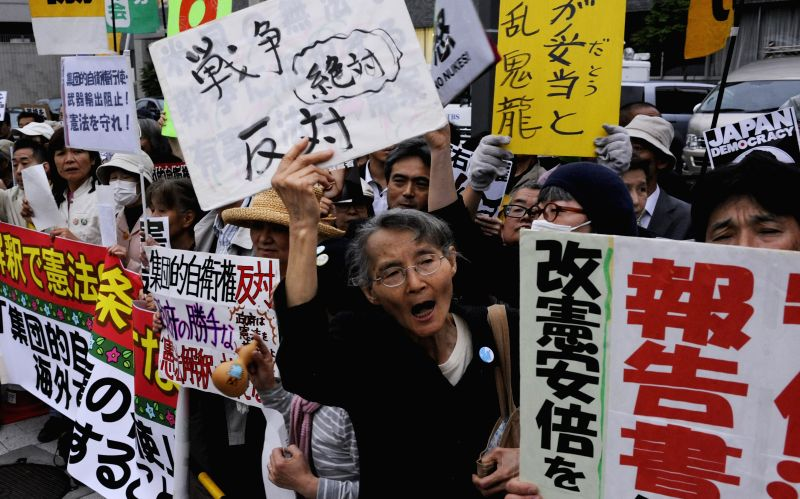 People protest against Abe's hand-picked panel of right-leaning experts attend a rally in front of the Prime Minister's official residence in Tokyo, Japan, May 15, ... - Shinzo Abe