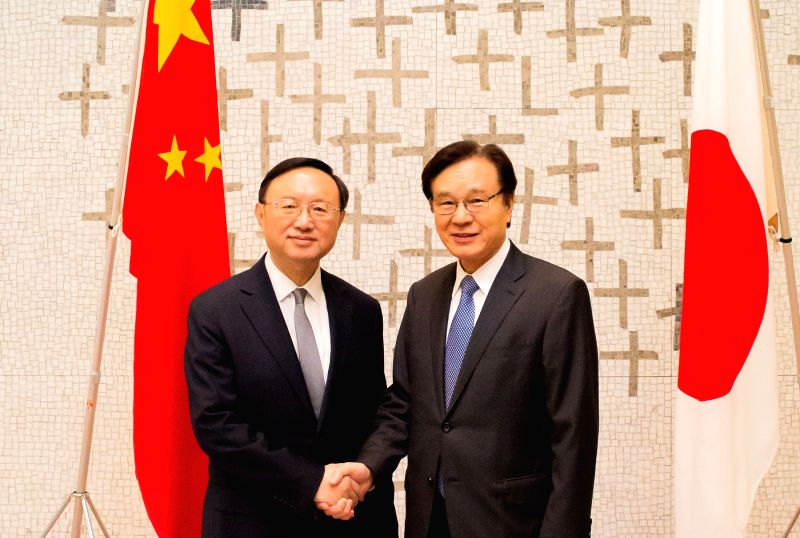 TOKYO, May 29, 2017 - Chinese State Councilor Yang Jiechi (L) shakes hands with Japan's National Security Advisor Shotaro Yachi as they co-chair the fourth round of China-Japan high-level political ...