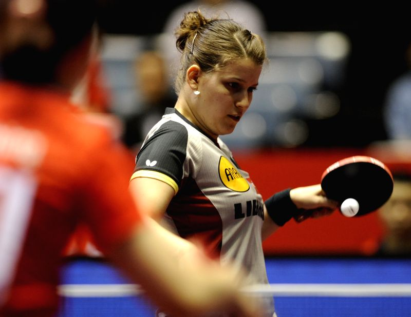 Petrissa Solja of Germany plays against Lee Ho Ching of China's Hong Kong during the quarterfinal match in Zen Noh 2014 World Table Tennis Championships in Tokyo, ...