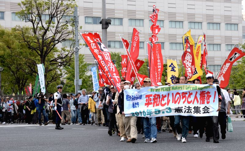 TOKYO, May 3, 2016 - Citizens holding placards and banners attend a protest rally in Tokyo, Japan, May 3, 2016. Some 50,000 people rallied in Tokyo on Tuesday on the occasion of the 69th Constitution ... - Shinzo A