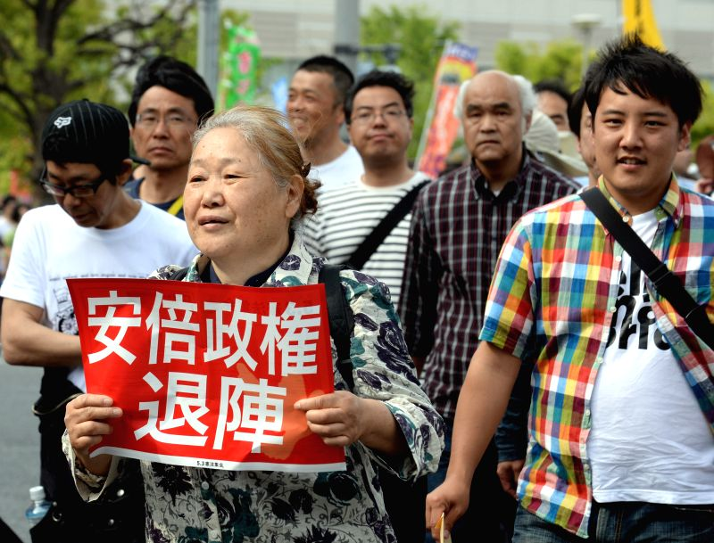 TOKYO, May 3, 2016 - Citizens holding placards attend a protest rally in Tokyo, Japan, May 3, 2016. Some 50,000 people rallied in Tokyo on Tuesday on the occasion of the 69th Constitution Memorial ... - Shinzo A