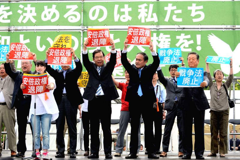 TOKYO, May 3, 2016 - Representatives of opposition parties holding placards attend a protest rally in Tokyo, Japan, May 3, 2016. Some 50,000 people rallied in Tokyo on Tuesday on the occasion of the ... - Shinzo A