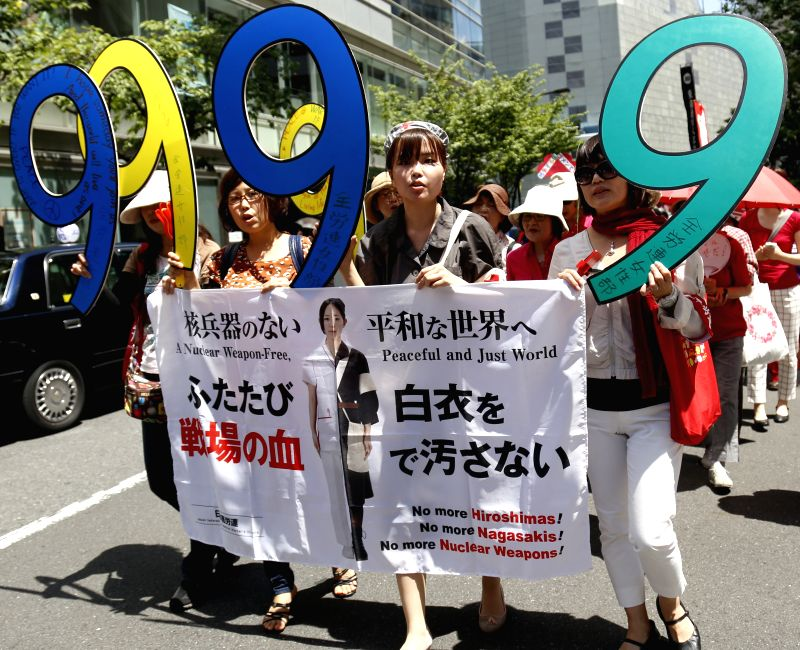 People hold banners during a demonstration against the controversial security legislations in Tokyo, Japan, May 14, 2015. Japanese Prime Minister Shinzo Abe will make a cabinet decision ... - Shinzo Abe