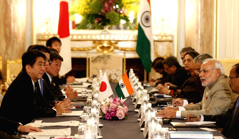 Japanese Prime Minister Shinzo Abe (1st L) holds talks with his Indian counterpart Narendra Modi (2nd R) in Tokyo, Japan, on Sept. 1, 2014. Japanese Prime Minister ... - Shinzo Abe and Narendra Modi