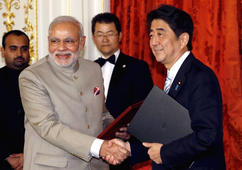 Japanese Prime Minister Shinzo Abe (R) shakes hands with his Indian counterpart Narendra Modi in Tokyo, Japan, on Sept. 1, 2014. Japanese Prime Minister Shinzo Abe ... - Shinzo Abe and Narendra Modi