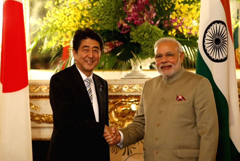 Japanese Prime Minister Shinzo Abe (L) shakes hands with his Indian counterpart Narendra Modi in Tokyo, Japan, on Sept. 1, 2014. Japanese Prime Minister Shinzo Abe ... - Shinzo Abe and Narendra Modi