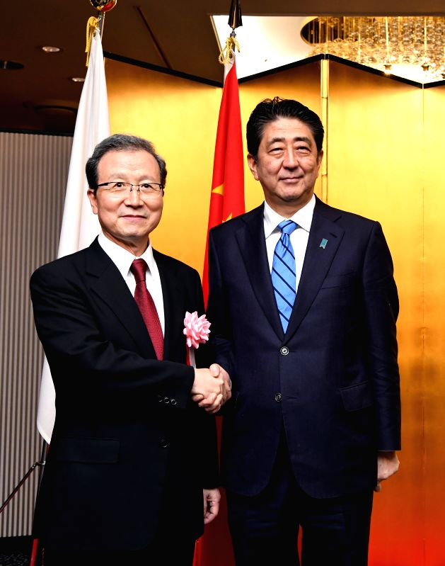 TOKYO, Sept. 28, 2017 - Japanese Prime Minister Shinzo Abe (R) shakes hands with Chinese Ambassador to Japan Cheng Yonghua at a ceremony marking China's upcoming National Day in Tokyo, Japan, Sept. ... - Shinzo Abe