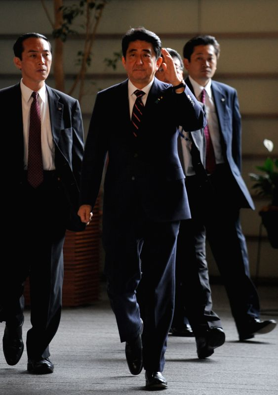 Japanese Prime Minister Shinzo Abe gestures as he enters the prime minister official residence in Tokyo, Japan, Sept. 3, 2014. Japanese Prime Minister Shinzo Abe will