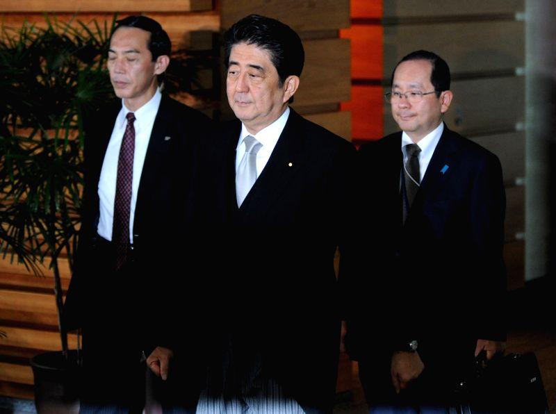 Japanese Prime Minister Shinzo Abe (C) leaves the prime minister official residence in Tokyo, Japan, Sept. 3, 2014. Japanese Chief Cabinet Secretary Yoshihide Suga ... - Shinzo Abe