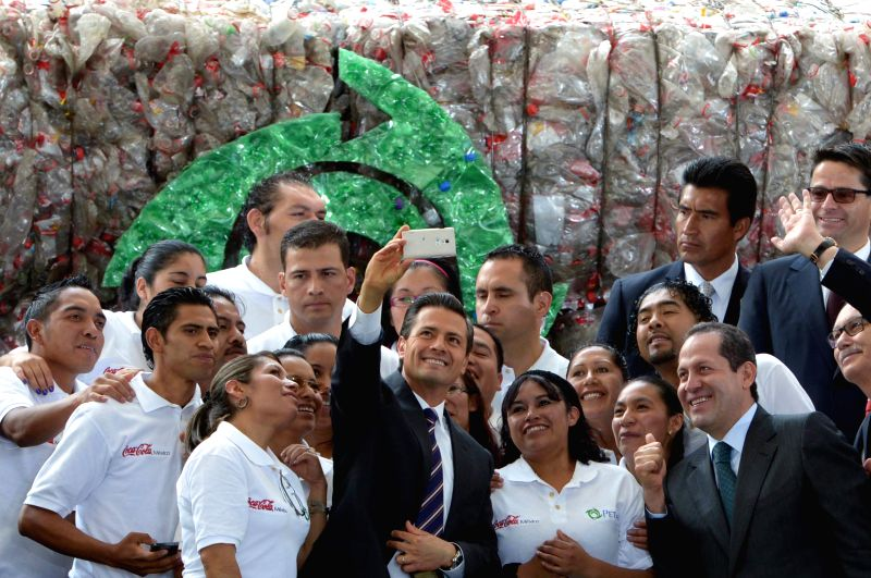 Image provided by Mexico's Presidency shows Mexican President Enrique Pena Nieto (C) and State of Mexico's governor Eruviel Avila (R) posing for photographs during ..