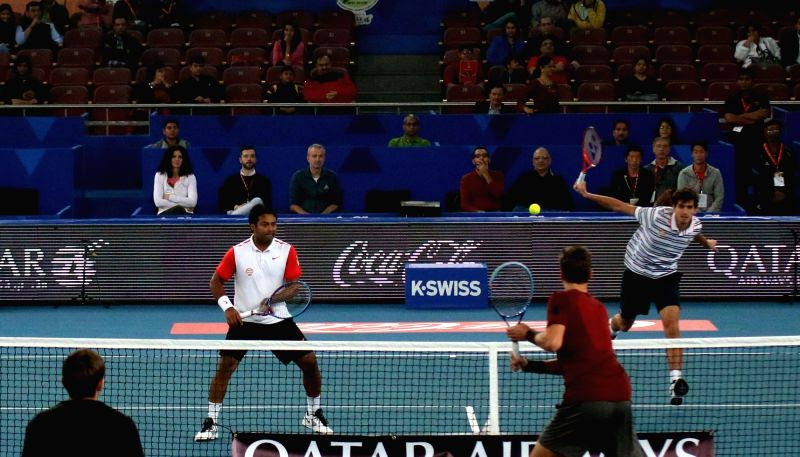Tomas Berdych and Daniel Nestor in action against Leander Paes and Pierre-Hugues Herbert during an IPTL match between UAE Royals and Legendari Japan Warriors at Indira Gandhi Stadium in ... - Indira Gandhi Stadium