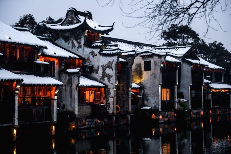 TONGXIANG, Jan. 29, 2018 - Photo taken on Jan. 28, 2018 shows scenery after a snowfall in Wuzhen, east China's Zhejiang Province.