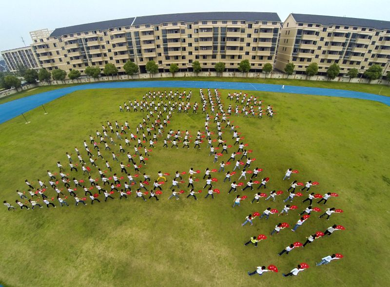 "Over 300 students form the Chinese character ""Wu""(martial) while performing Kongfu with fans at Chongde Primary School in Chongfu Town of Tongxiang City,"