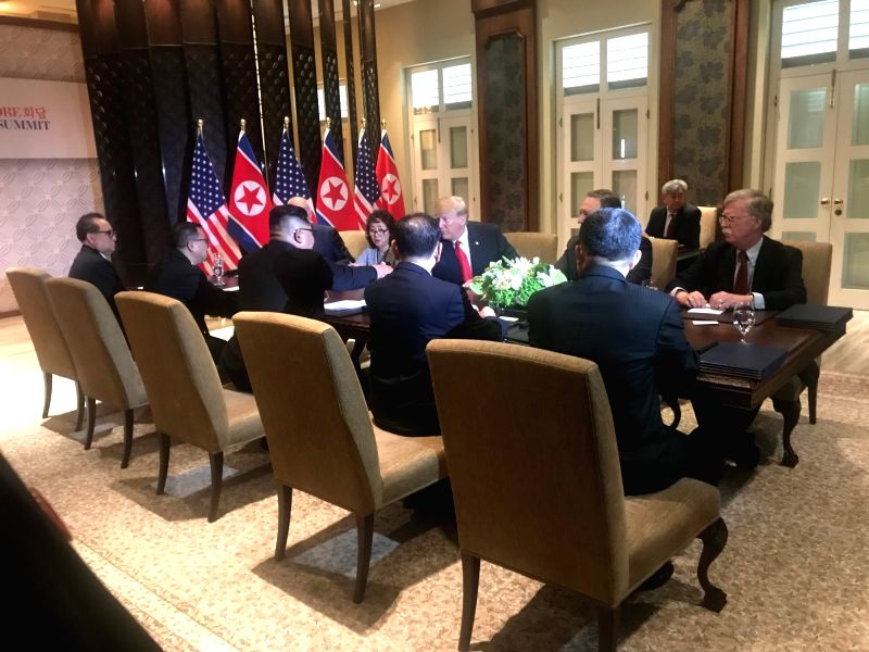 Top leader of the Democratic People's Republic of Korea (DPRK) Kim Jong Un (3rd L) holds talks with U.S. President Donald Trump (3rd R) in Singapore