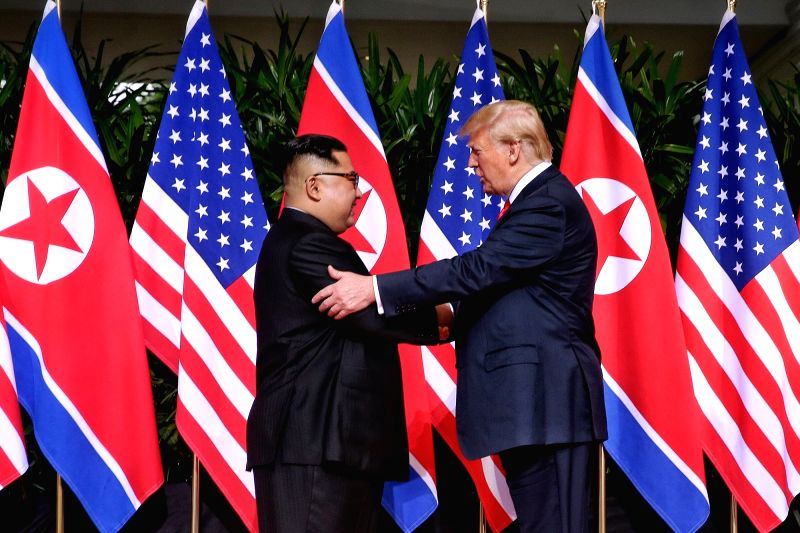 : Top leader of the Democratic People's Republic of Korea (DPRK) Kim Jong Un (L) shakes hands with U.S. President Donald Trump in Singapore before the ...