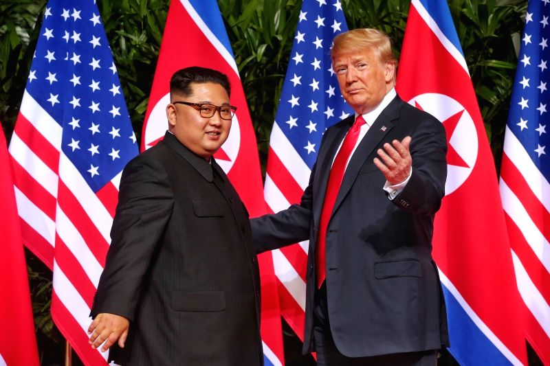 : Top leader of the Democratic People's Republic of Korea (DPRK) Kim Jong Un (L) meets with U.S. President Donald Trump in Singapore, on June 12, 2018. ...