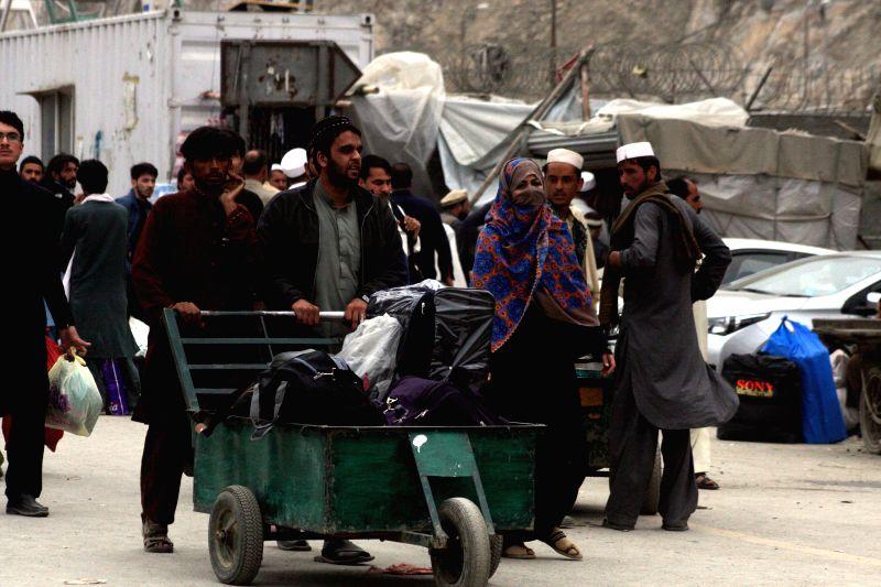 TORKHAM (PAKISTAN), March 20, 2017 People arrive to cross Pakistan-Afghanistan border in northwest Pakistan's Torkham, on March 20, 2017. Pakistani Prime Minister Nawaz Sharif on Monday ... - Nawaz Sharif